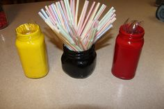 DIY Mickey Birthday  Painted mason jars or old sauce jars to hold utensils and straws in mickey colors