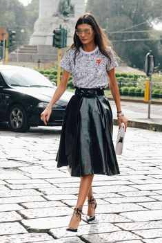 Edgy look with leather mid skirt
