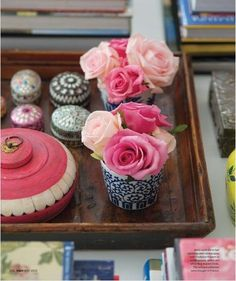 * A collection of pillboxes displayed in a vignette of blue and whites, and pink accents. Pretty!