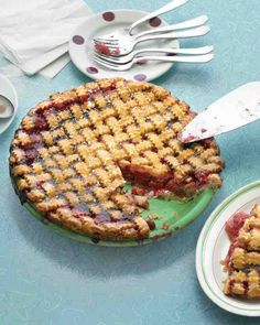 Sour Cherry Pie - The perfect combination of tart and sweet, this familiar dessert -- crowned with an old-fashioned lattice crust -- evokes an era when every afternoon included pie and coffee.