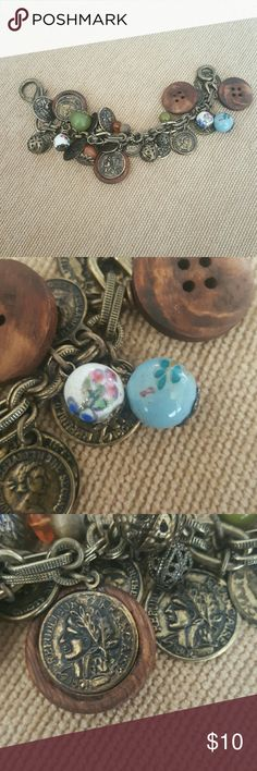 Bracelet Greek looking coins, wood buttons and clausenae looking beads Jewelry Bracelets