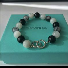 Authentic Tiffany & Co. Paloma Picasso NEW! This bracelet is no longer available at Tiffany & Co. and very HTF! NEVER WORN!! This is a sterling silver moonstone quartz onyx bead bracelet. This gorgeous bracelet measures 8.25 inches long x 10.55 wide beads. Weighs 27.1 grams. Pouch & Box Included! NO BUNDLE DISCOUNT! Please feel free to make a reasonable offer! Tiffany & Co. Jewelry Bracelets
