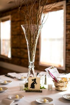 Snow White inspired wedding. Claret vases with curly willow branches, moss and apples for an enchanted forest look. Animals instead of table numbers for seating assignments. Photo by Stephiejoy.com