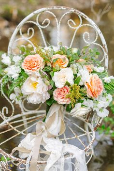 Breathtaking lush peach, white and green wedding bouquet. @weddingchicks