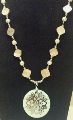 "Beautiful Mother of Pearl teal pendant with silver design. Pendant almost 2"" all around. Necklace is made with glass clear/silver beading and abalone shell beading. Claw closure, necklace is 23"" long. Bid starting at $15 on ebay."