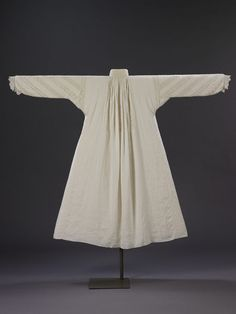A woman's fine linen smock of the period 1620-1640. Women's smocks were always made with triangular gores in either side and the high neck and long sleeves of this example, trimmed and inset with bobbin lace arranged in a distinctive diagonal pattern, were clearly meant to be seen when the wearer was fully dressed. The lace insertions are of the same design, but two different qualities, one finer than the other. and five different patterns of lace are included.