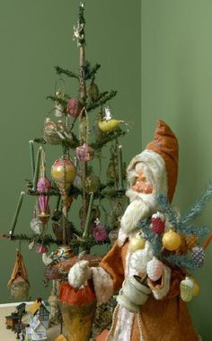 Antique feather tree and nodder Santa  http://www.hometraditions.com/taft_museum_of_art_christmas_2005_s/1953.htm