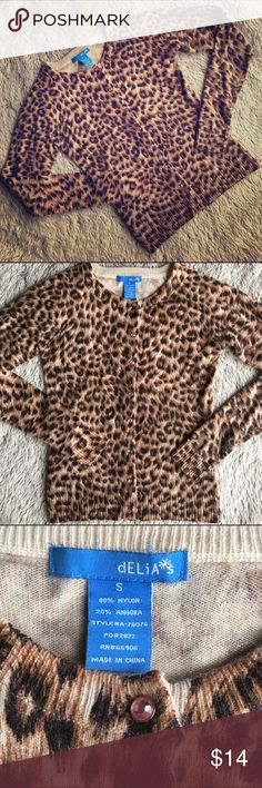 Leopard Print Cardigan Angora blend leopard print cardigan in great shape. Has pink jeweled buttons. It's a form fitting cardigan. Third button from the bottom is missing a pink jewel. See last pic. Other than that in excellent condition Sweaters Cardigans