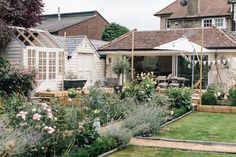 The transformation of a large garden with lawn to a cottage style garden with filled borders, potting shed, summerhouse and gravel patio