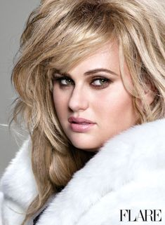 Rebel Wilson pumps up the glam in a white faux fur look | Hair by Robert Vetica.