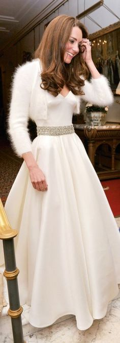 4/29/11 - A closeup of Kate's reception gown. Also by Sarah Burton for Alexander McQueen. It features what looks like a cashmere or Angora shawl and a crystal belt. Gorgeous!