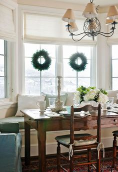 love the mix of white, blue, green and wood.  Window treatments and seating for bfast nook!