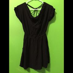 Black dress Short black dress with pockets. The back has a crisscross type of style with a v cut Dresses Mini