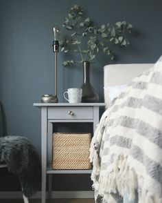 Bedroom with dark walls and Ikea hemnes bedside table hack.