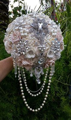 PINK AND IVORY Custom Jeweled Cascading Brooch Bouquet- Deposit for this Custom Bouquet, brooch Bouquet, jeweled Bouquet by Elegantweddingdecor on Etsy https://www.etsy.com/listing/241115811/pink-and-ivory-custom-jeweled-cascading