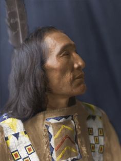 Little Dog - Brulé Lakota Sioux - American Indian Colorized from the c1907 photograph by Edward S. Curtis. Head-and-shoulders of Native American man, facing right.