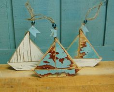 Love this Etsy store and everything in it! Sailboat Ornaments Shabby Chic Christmas Sign Weathered White Beach House Sailboat - Set of Three. $21.00, via Etsy.