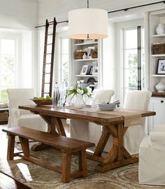 Neutral dining room - slipcovered chairs, bench, trestle table, library ladder, drum pendant