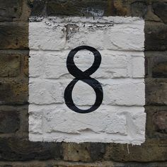 paint white square and paint house number in it.