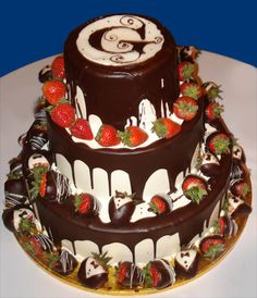 Chocolate cake, strawberry filling, vanilla icing with ganache and fresh strawberry decorations