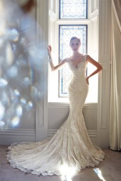 Beautiful lace mermaid dress from Sophia Tolli: http://www.stylemepretty.com/2014/11/03/21-of-our-favorite-lace-dresses/