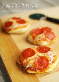 Mini Biscuit Pizzas - A family favorite by a landslide! These are so easy to make I could cry. #minipizzas #biscuitpizzas #kiddinners