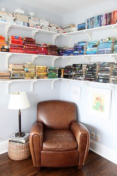 I wonder if Kevin would let me put up some shelving like this in our future office...