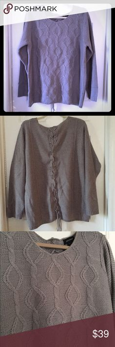Gray Cable Knit Sweater with Corset Tie in back Great unique sweater by Lane Bryant. Worn twice, this is a super comfy sweater and it has just gotten a little too big for me to wear. It has the corset tie in the back which is such a cute detail. Ashley Stewart Sweaters Crew & Scoop Necks