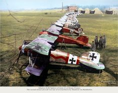 German Albatros D.IIIs of Jagdstaffel 11 and Jagdstaffel 4 parked up at Roucourt, near Douai, France April 1917. In this famous shot the Red Baron's Albatros D.III is second from the front, its black crosses barely visible against the red overspray. Its upper wing bears standard German green and mauve camouflage.