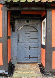 Neptune's symbol on door on the door of Ærøskøbing oldest house built in 1645.Notice the steps.