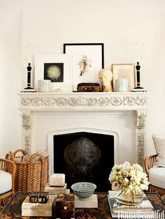"""How To Style Your Coffee Table: In the living room of a West Hollywood house, the mantel and coffee table display designer Mark D. Sikes's passions: boxes, books, and art from China and Paris flea markets. """"When I see an empty table, I shudder a bit,"""" he says. """"There are times when minimalism can be the right thing. A table with one vase of flowers and one little accessory is thoughtful, while a gorgeous table with copies of Us and People magazines just looks neglectful."""""""