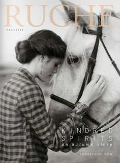 Ruche Magazine features Downton Abbey star, Michelle Dockery and a handsome white steed on the cover of their fall fashion issue.