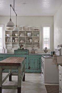 Vintage Home Tour - the rustic distressed wall unit fits with the style of the home and is a cost-effective way to add storage to a kitchen - via Vintage Whites:  Christmas Tour