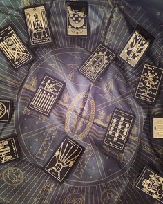 A tarot cloth with symbols - learn to create your own tarot spreads while being guided with a luxurious silk cloth. Pictured with the Golden Thread Tarot Deck.