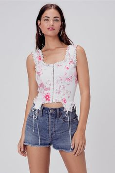 Sweetly feminine stretch denim bustier top featuring tonal cotton eyelet trim detailing throughout. Decorative ties at hem. Functional hook-and-eye closures at front. Fully lined Fitted Silhouette Holiday Lingerie, Lingerie For Sale, Bustiers, Men's Accessories, Bustier Top, Camisole Top, Denim Mini Skirt, Mini Skirts, Creme Puff