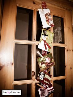 Merry Mail! Velcro a ribbon on the fridge so all cards can be pinned with clothespin! Nice & Net!