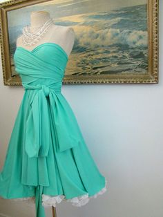 i like the style of the skirt and how the material wrapping around the waist goes into a bow