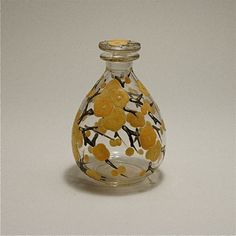 Delvaux 1920s art glass perfume bottle and stopper in clear glass with enameled detail. Signed Delvaux. 4 1/2 in.