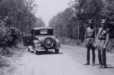 """Photo: snapshot by unknown photographer of spot where Bonnie & Clyde were ambushed, 23 May 1934. Credit: FBI; Wikimedia Commons. Credit: Library of Congress, Prints and Photographs Division. Read more on the GenealogyBank blog: """"Violent End to Bonnie and Clyde's Life of Crime"""" https://blog.genealogybank.com/violent-end-to-bonnie-and-clydes-life-of-crime.html"""