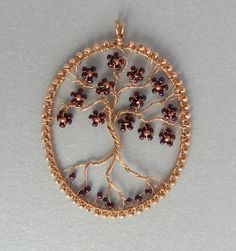 Athene Tree of Life wire-wrapped bronze pendant with iridescent bead flowers. £24.00, via Etsy.