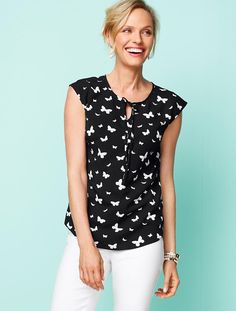 Butterfly-Print Shirt Blouse.  I PREFER LONGER SHORT SLEEVE LENGTHS, BUT LIKE THE PATTERN OF THIS TOP AND THAT IT IS MACHINE WASHABLE.