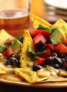 Beer Queso Nachos. Beer cheese sauce. Get it into ya!