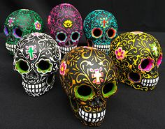 6 exquisitely hand-painted clay sugar skulls.