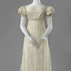 Wedding dress with puffed sleeves, anonymous, silk,  = worn in 1822. However, neither the cut nor the fabric indicates that this gown was meant for such an occasion. The high waist, low neckline, puffed sleeves, and ankle length skirt are typical of the period. The silk fabric is woven with a fashionable, dainty scattered pattern. http://hdl.handle.net/10934/RM0001.COLLECT.51067