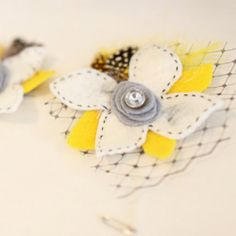 This darling online boutique features handmade boutonnieres, hair accessories, veils, and more :)