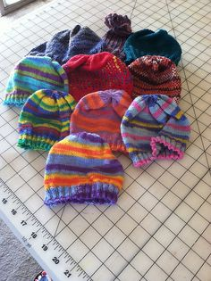 Wendy's Hats for A4A - some in My First Regia sock yarn.