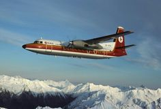 """National Airways Corporation - NAC Fokker Friendship ZK-NFA """"Kotuku"""" in flight over the New Zealand Alps, circa (Image: Didier Pinçon) Vintage Air, Vintage Travel, Plane Icon, Australian Airlines, Cool Backdrops, Cargo Aircraft, Air New Zealand, Commercial Aircraft, Air Travel"""