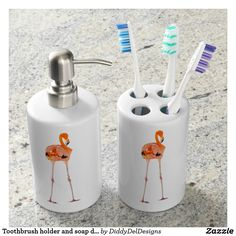Toothbrush holder and soap dispenser with flamingo design in peach pink and orange feathers.
