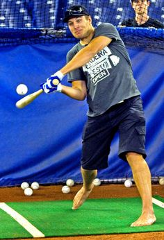 Luke Schenn thinks he plays baseball...  I just want to know why he doesn't have shoes on