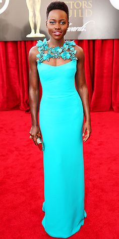 Lupita Nyong'o in custom turquoise Gucci gown with floral embroidery at neckline at SAG Awards